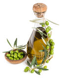 Olives and olive oil in a bottle Royalty Free Stock Photography