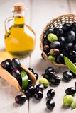 Olives And Olive Oil. In a Bottle Royalty Free Stock Photo