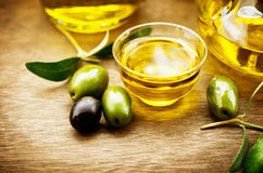 Olives and olive oil. Bottle of virgin olive oil Royalty Free Stock Photo