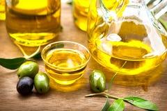 Olives and olive oil. Bottle of virgin olive oil Stock Images