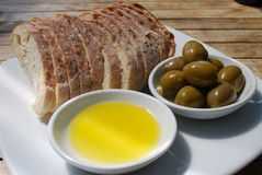 Olives with olive oil and bread Royalty Free Stock Photos