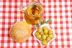 Olives, olive oil and bread Stock Photos