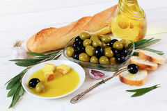 Olives, olive oil, bread and garlic Royalty Free Stock Image