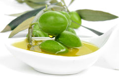 Olives and olive oil Royalty Free Stock Images
