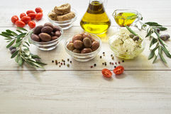 Olives, olive oil, feta cheese. royalty free stock photography