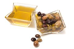Olives with olive oil. Isolated on a white background Stock Images