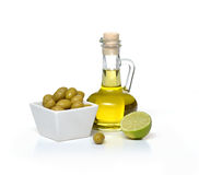 Olives and olive oil and lime on white background. Olives citrus lime oil bottle Royalty Free Stock Image
