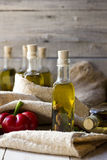 Olives and olive oil in mini bottle on wood Stock Images