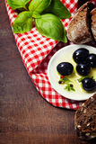 Olives and Olive Oil on an old tablel royalty free stock photography
