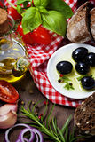 Olives and Olive Oil on an old tablel Stock Photography