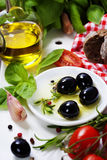 Olives and Olive Oil on an old tablel Royalty Free Stock Photo