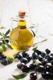 Olives And Olive Oil. In a Bottle Royalty Free Stock Images
