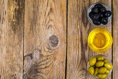 Olives with olive oil. Studio Photo Royalty Free Stock Image