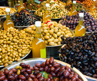 Olives and olive oil for sale Stock Image