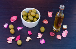 Olives and olive oil. Some olives and a small bottle of olive oil Royalty Free Stock Images