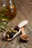 Olives with olive oil and spices Stock Images