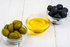 Olives with olive oil. Studio Photo Royalty Free Stock Photo