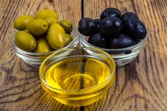 Olives with olive oil. Studio Photo Stock Photo