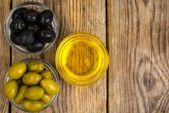 Olives with olive oil. Studio Photo Stock Photos