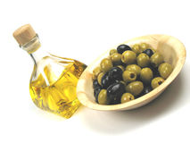 Olives and olive oil tilted to the left Stock Photos