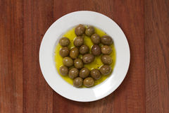 Olives in olive oil on white plate Stock Image