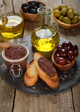 Olives and olive oil Stock Photos