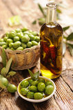Olives and Olive Oil. On wooden table Stock Photography