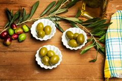 Olives and olive oil. On a wooden table Stock Image