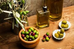 Olives and olive oil. On a wooden table Stock Photography