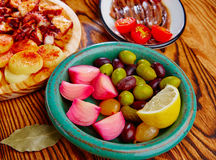 Olives onion pickles tapas anchovies and octopus Royalty Free Stock Photography