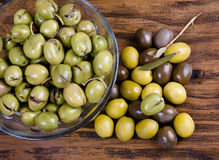 Olives over wood table. Royalty Free Stock Image