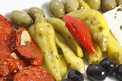 Olives papper and tomato. On the white background Royalty Free Stock Images