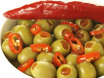 Olives with paprika Stock Images