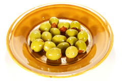 Olives with paprika inside. On plate isolated on white Royalty Free Stock Photo