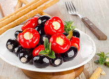Olives and peppers filed with  cheese Royalty Free Stock Images