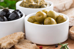 Olives, pesto, fresh vegetables and ciabatta Stock Images