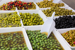Olives in pickle. Assortment of olives salted preserved in pickle at the italian market Royalty Free Stock Photography