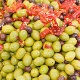 Olives in pickle. Appetizer of olives in pickle with tomato Stock Photography