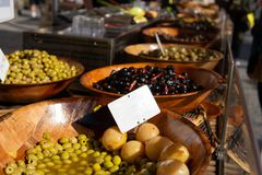 Olives and pickled vegetables for sale at farmers market royalty free stock photo