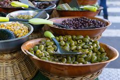 Olives and pickled vegetables for sale at outdoor market royalty free stock images