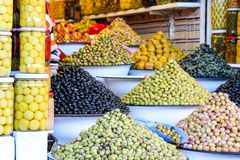 Olives and pickles on display at a farmers market Royalty Free Stock Photos