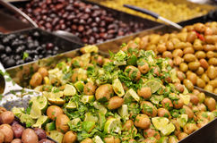 Olives, pickles and salads on market stand Stock Images