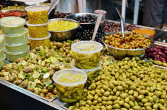 Olives, pickles and salads on market stand. Assortment of olives, pickles and salads on market stand royalty free stock photo