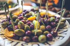 Olives on the plate Stock Photos