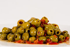 OLIVES ON A PLATE WITH HERBS with Peppers Royalty Free Stock Photography