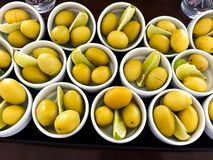 Olives portions and lemon. Close up background royalty free stock images