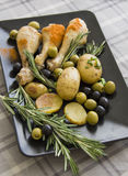 Olives, potatoes and chicken parts Stock Photos