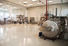 Olives production. Production of olives. sterilizing machine in the foreground Royalty Free Stock Photography