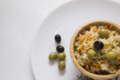 Olives and rice closeup in a bowl Stock Image