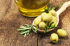 Olives with rosemary and olive oil Stock Photo